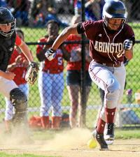 Abington's Toni Washington bunts, bringing one rbi home during the May 20, 2015 game at Souderton. (Bob Raines--Montgomery Media)