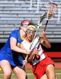 Souderton's Carlie Doughty tries to push past Downingtown West's Meg Graham (Bob Raines--Montgomery Media)