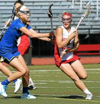 Souderton's Amber Lambeth makes a cut for the goal past Downingtown West's Heather Camden (Bob Raines--Montgomery Media)