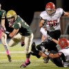 Lansdale Catholic's Ryan Quigley spins away from Archbishop Carroll's Harry Rohlfing during their game on Friday, Oct. 23, 2015. (Bob Raines/Montgomery Media)