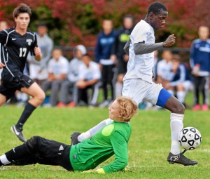 North Penn's Musa Sheriff (9) controls a ball past sprawling Strath Haven goalkeeper Adam Schultz (1) for a goal during first0half action of their contest at North Penn High School on Tuesday, Oct. 27, 2015. (Mark C Psoras/The Reporter)
