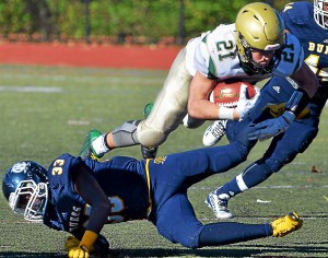 Lansdale Catholic's Ryan Quigley (21) is upended by West Catholic defender Jahmere Crumpton (33) during second half action of the PCL Class AA final at Cardinal O'Hara High School on Saturday, Nov. 14, 2015. (Mark C Psoras/The Reporter)