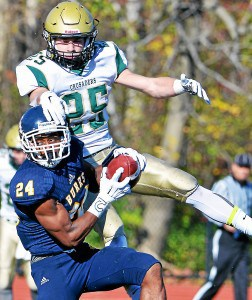 West Catholic reciever Craig Jones (24) pulls in a pass in front of Lansdale Catholic defender Marlen Fenstermacher (25) during second half action of the PCL Class AA final at Cardinal O'Hara High School on Saturday Nov. 14, 2015. (Mark C Psoras/The Reporter)